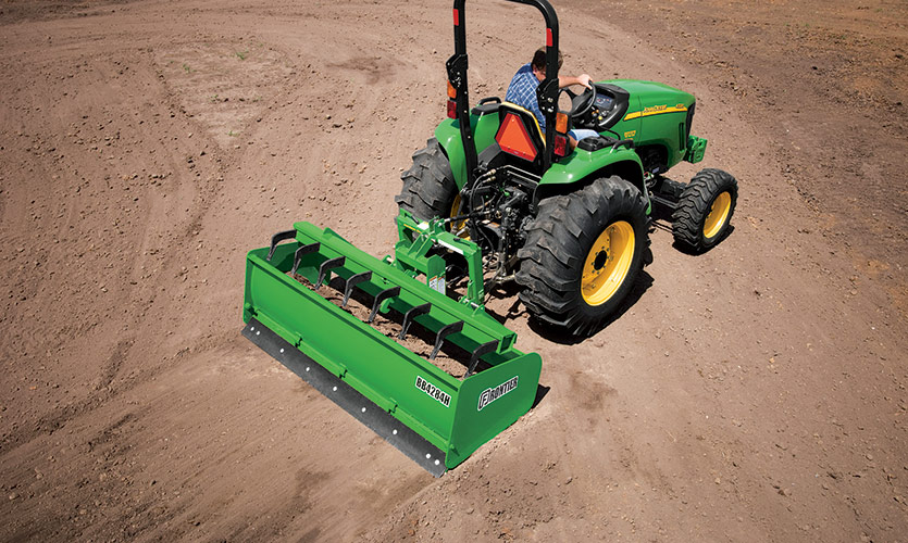 A Frontier Box Blade with Hydraulic Scarifiers.