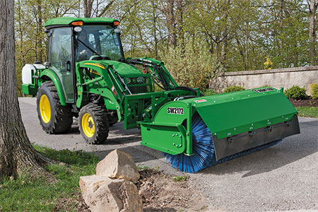 Use a Frontier Rotary Broom to remove driveway gravel from grass.