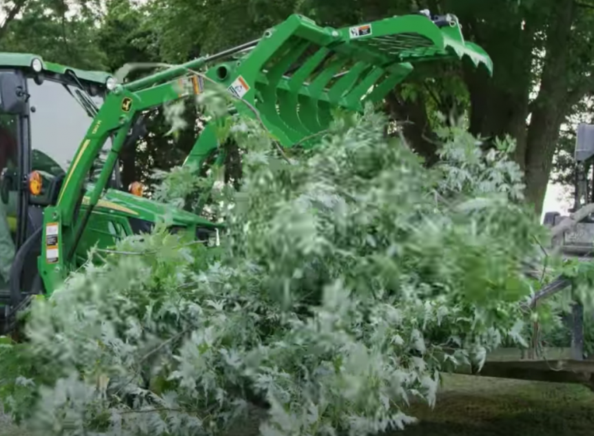 Cleaning up tree branches using a Frontier Root Grapple.