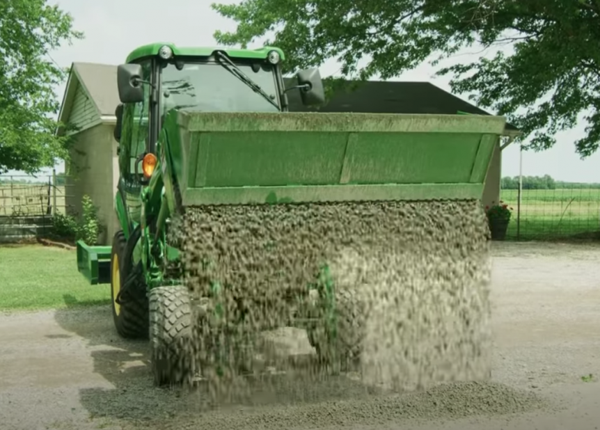 Using a Frontier 4-in-1 Bucket to maintain a gravel drive.