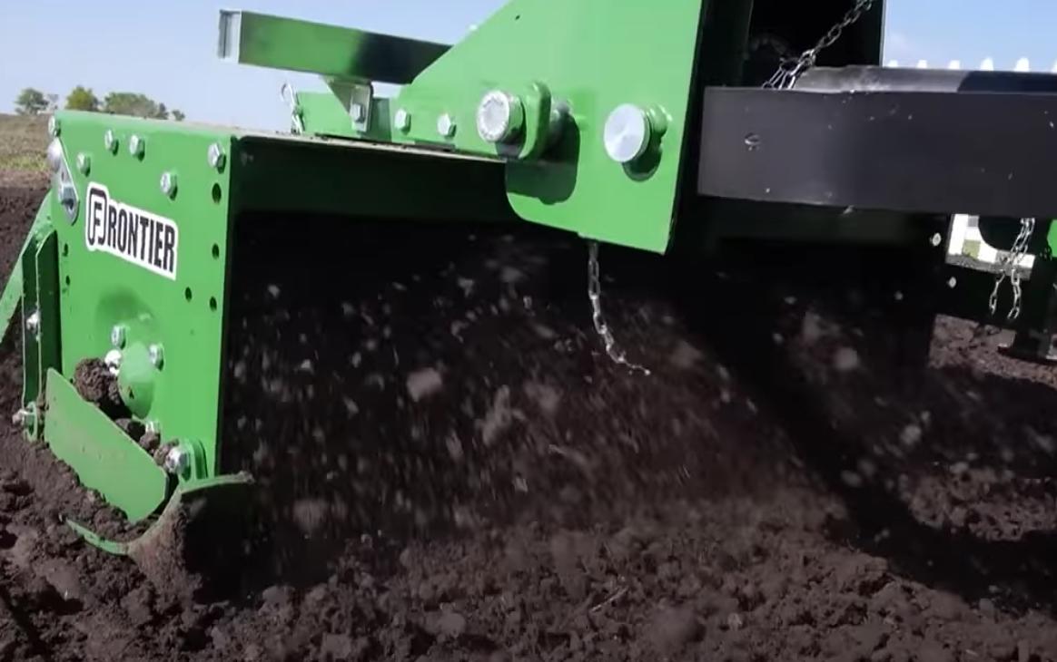 Using a rotary tiller.